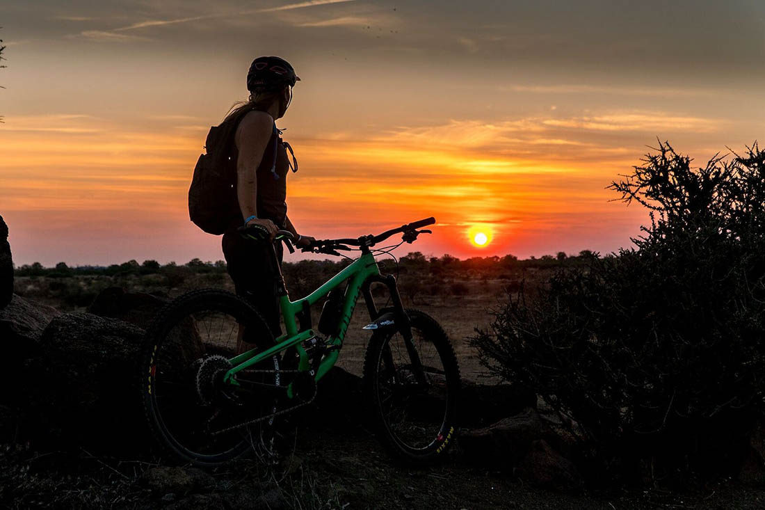 Juliana Bicycles - Anka Martin Looking Off Into the Sunset with Bike in Hand