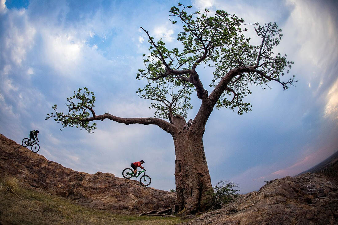 Juliana Bicycles - Anka and Mosa Riding Beneath a Tree in Africa